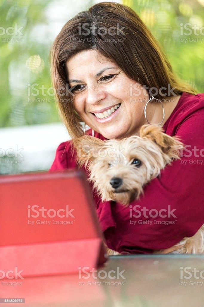 Hispanic woman with her dog stock photo