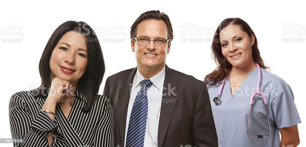Hispanic Woman with Husband and Female Doctor or Nurse stock photo