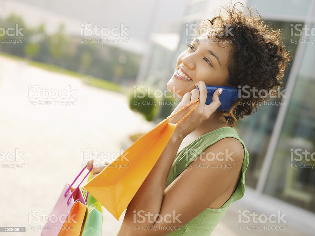 hispanic woman with shopping bags royalty-free stock photo