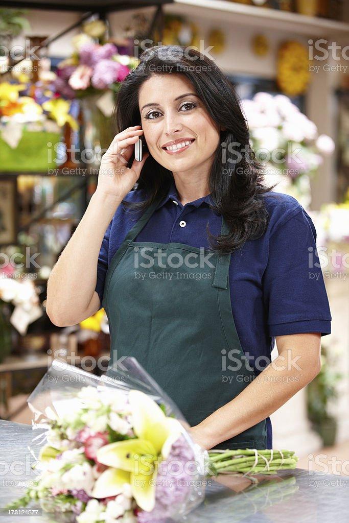 Hispanic woman working in florist stock photo