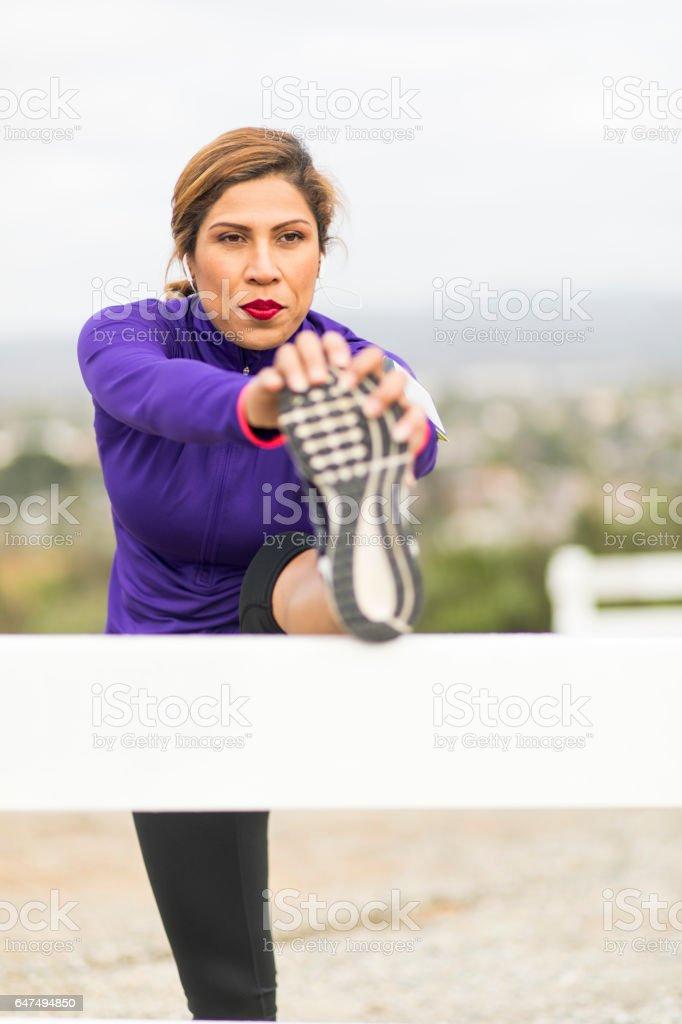 Hispanic Woman Working Out stock photo