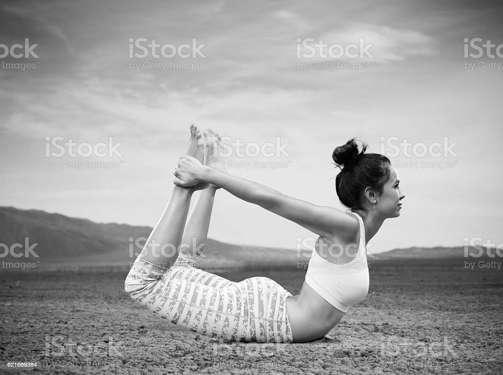 Hispanic Women Doing Yoga In The Desert stock photo