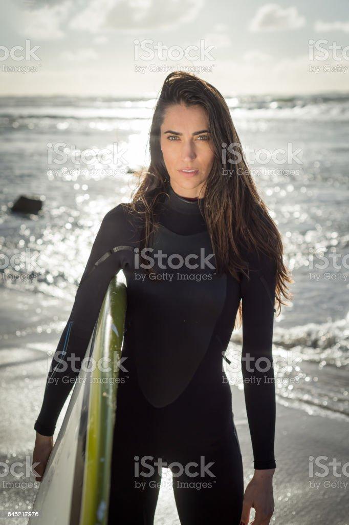 Hispanic Women With Her Surboard stock photo