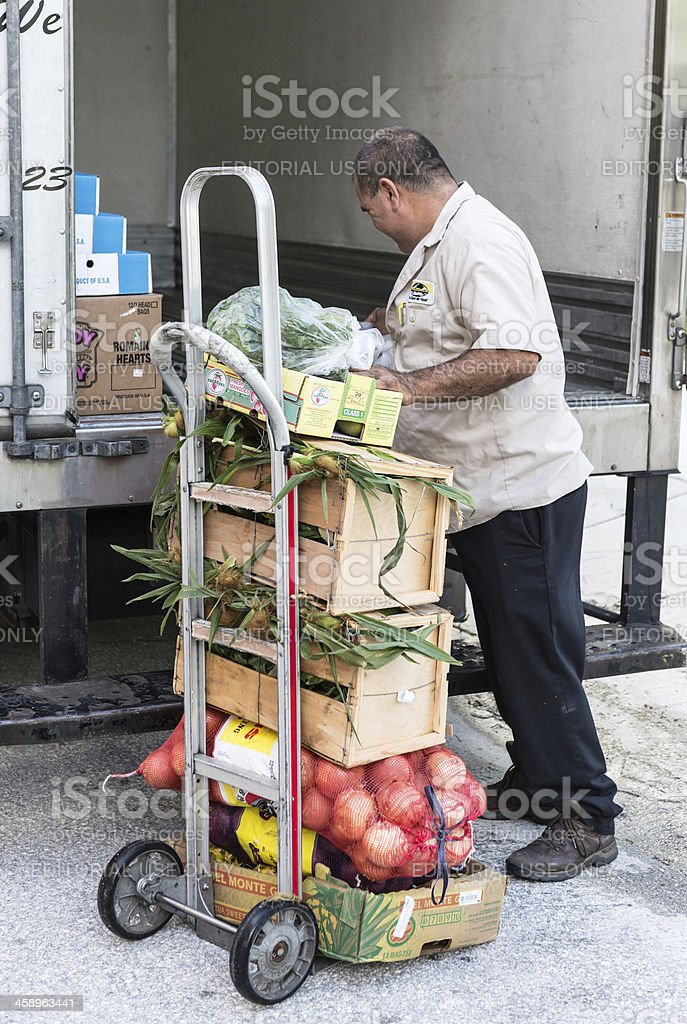 Hispanic worker delivering food stock photo