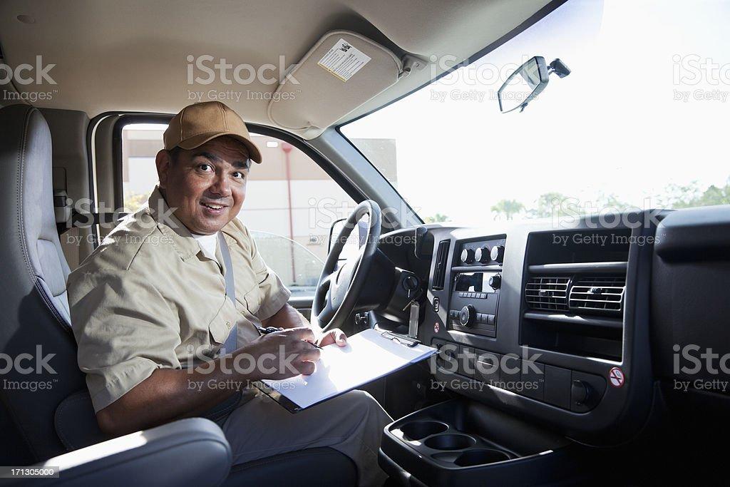 Hispanic worker driving van royalty-free stock photo