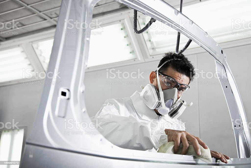 Hispanic worker in auto body shop royalty-free stock photo