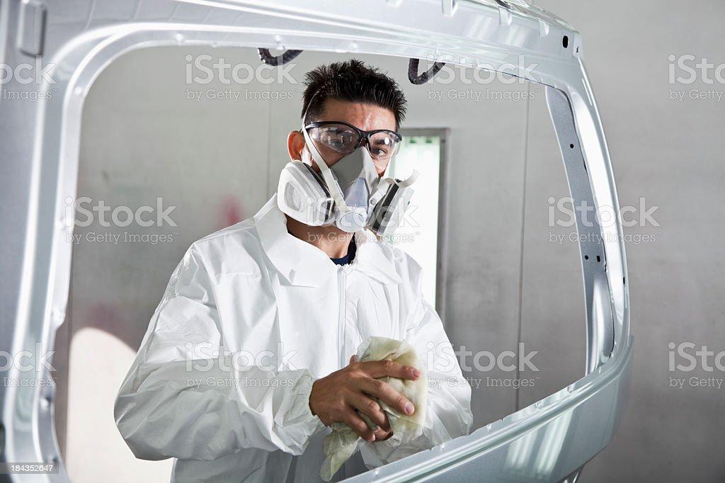 Hispanic worker in auto body shop royalty-free stock photo