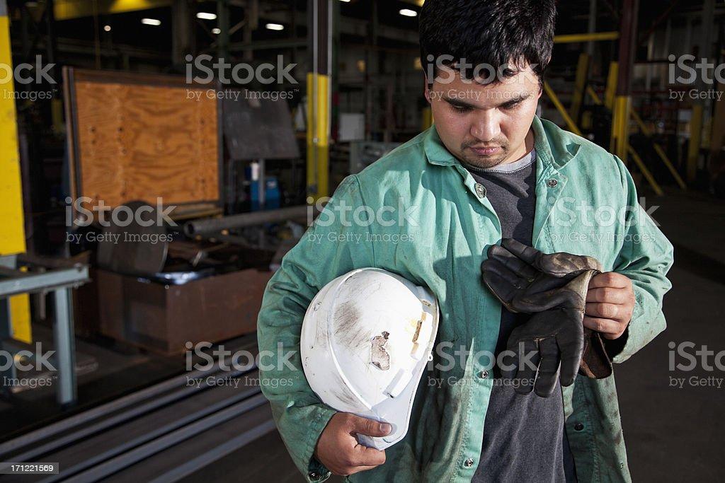 Hispanic worker in fabrication shop royalty-free stock photo