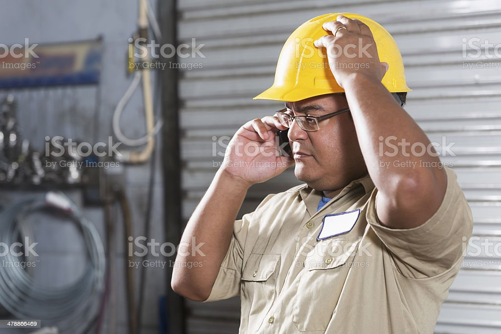 Hispanic worker wearing hardhat royalty-free stock photo