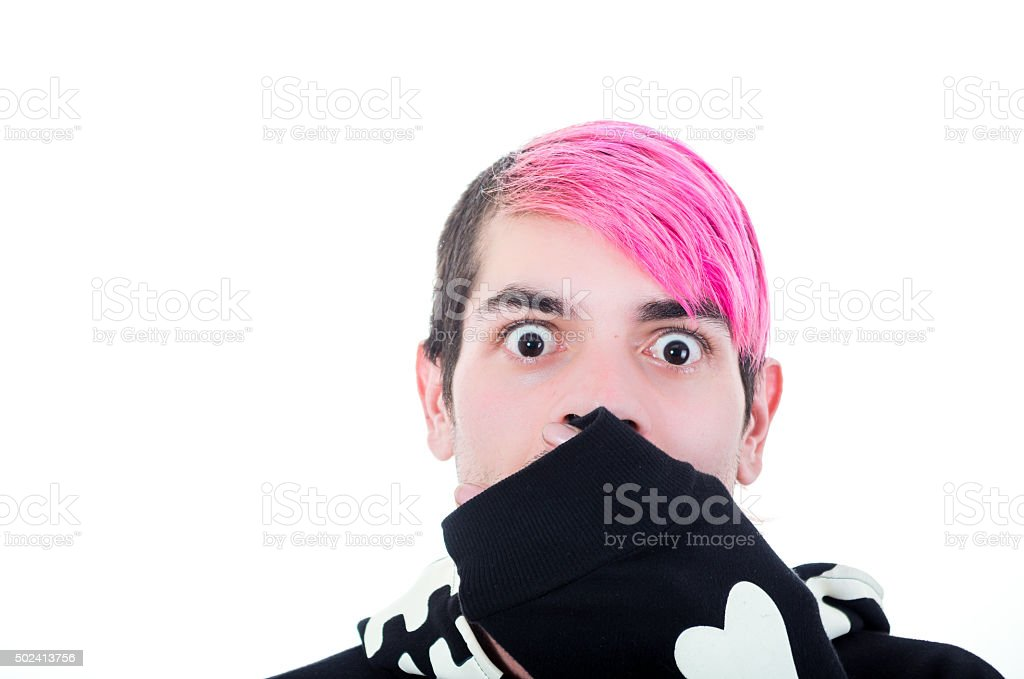 Hispanic young adult with pink hair and black skeleton hoodie stock photo