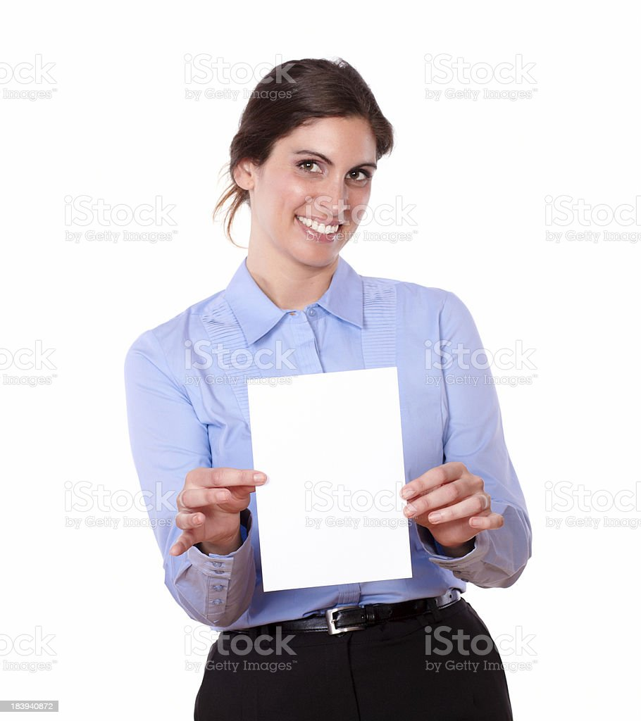 Hispanic young woman smiling and holding a card royalty-free stock photo