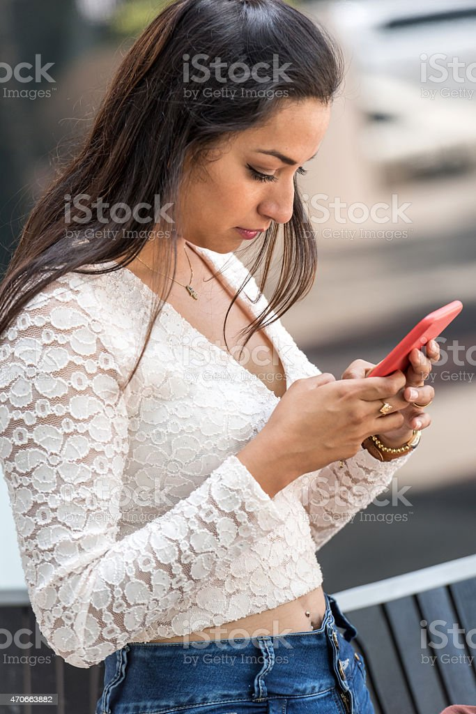 Hispanic Young Woman Texting stock photo