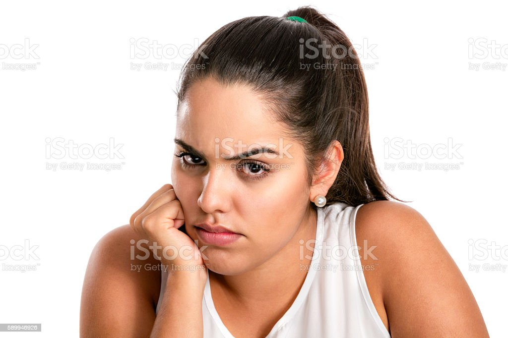 Hispanic young woman with angry and serious expression stock photo