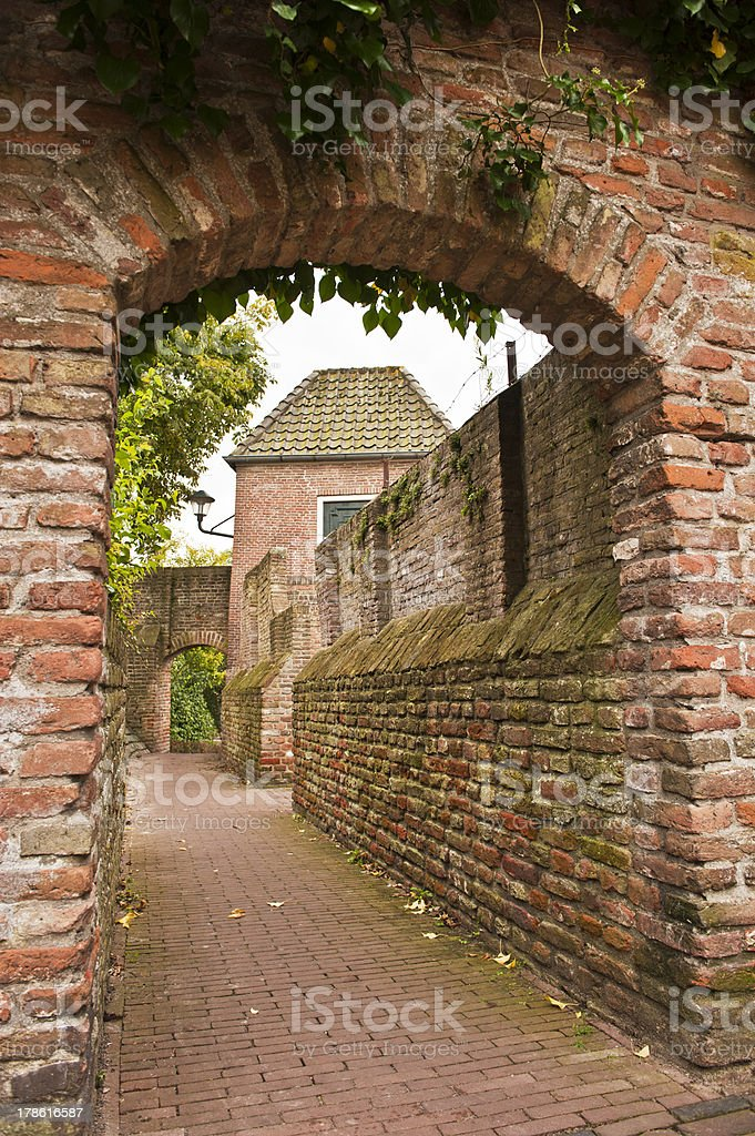 Historic alley see through a arch gate royalty-free stock photo