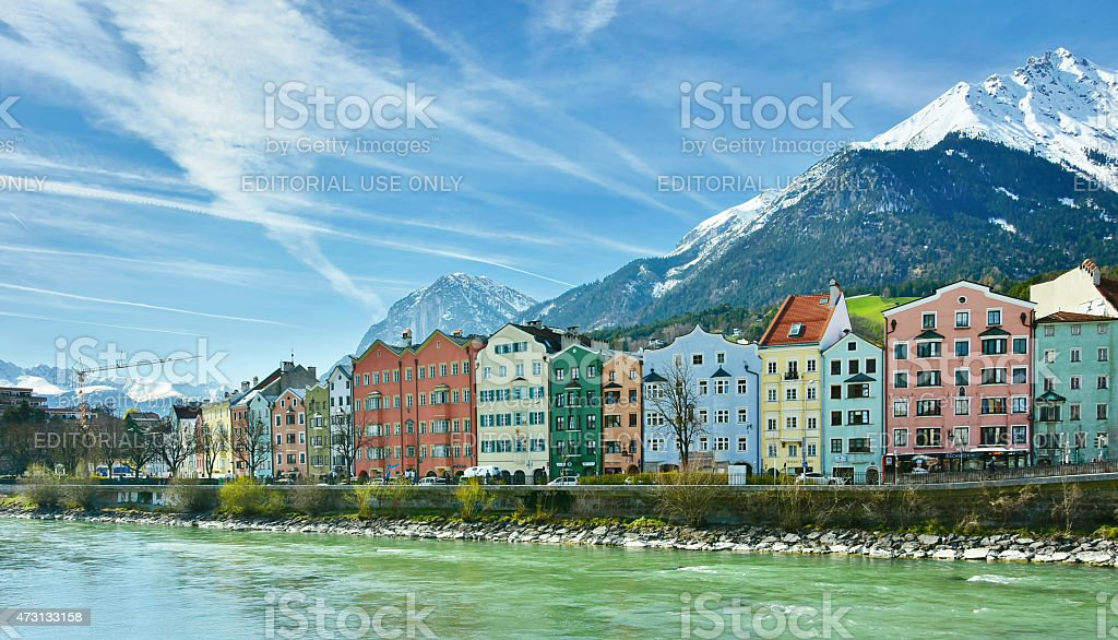 Historic architecture and snow capped mountains in Innsbruck, Au stock photo