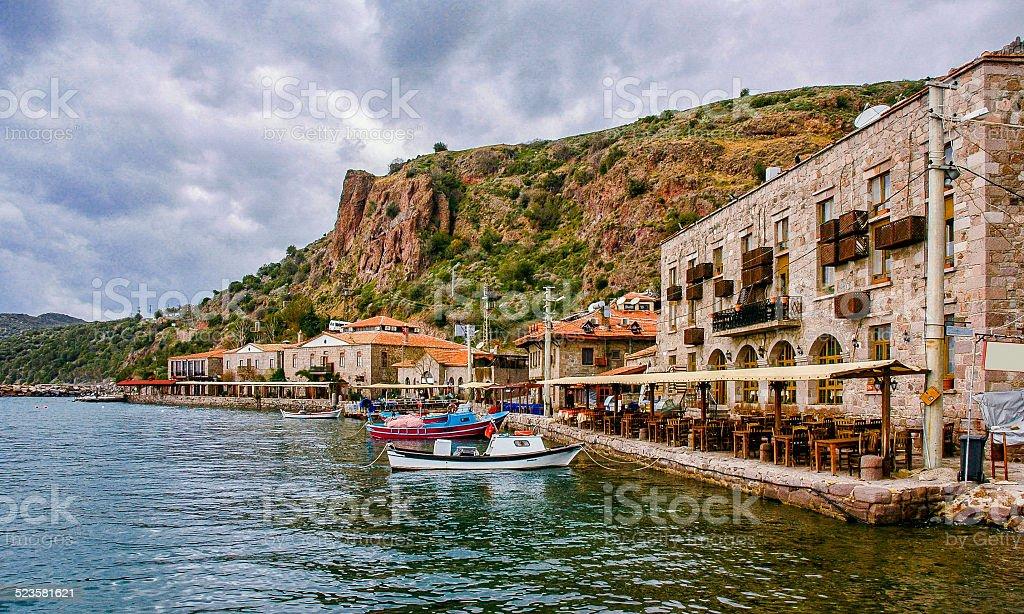 Historic Assos town near Aegean Sea with fishing boats stock photo