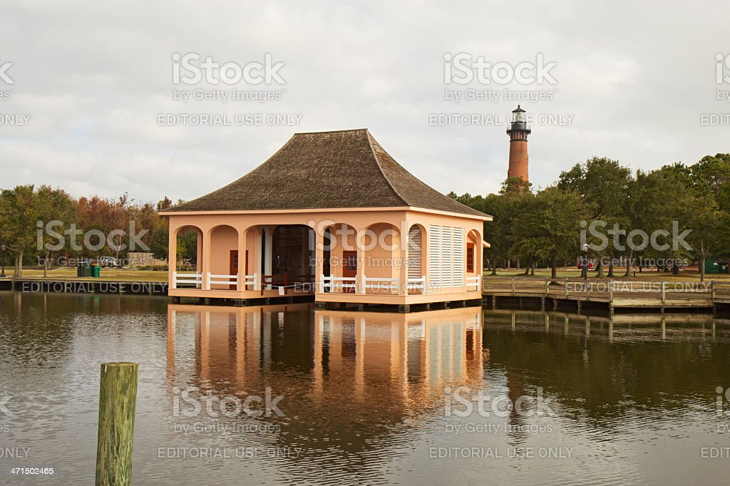 Historic boathouse and Currituck Beach Lighthouse near Corolla, North Carolina royalty-free stock photo
