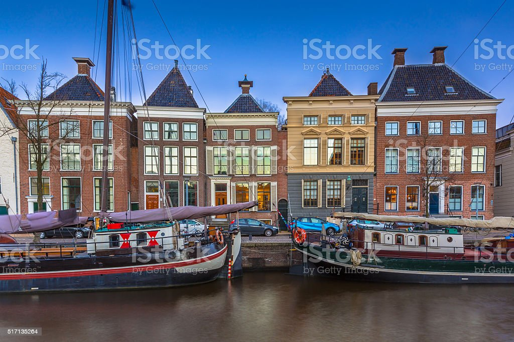 Historic boats and buildings Groningen stock photo