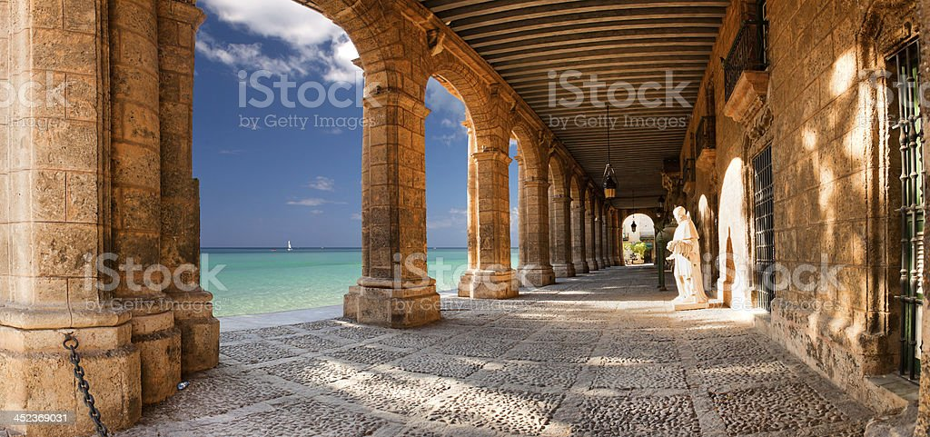 Historic building with arches and statues stock photo