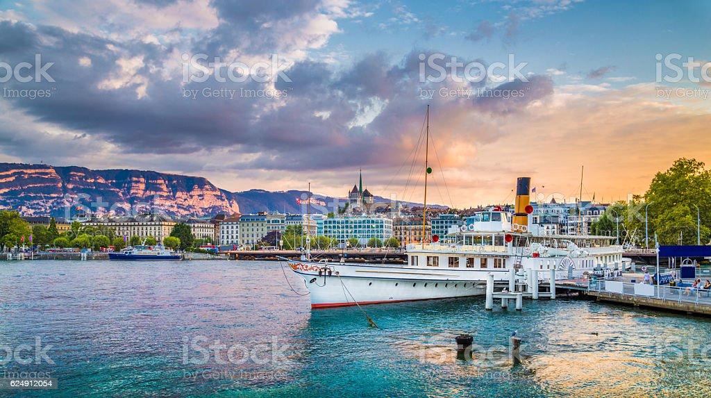 Historic city of Geneva with paddle steamer at sunset, Switzerland stock photo