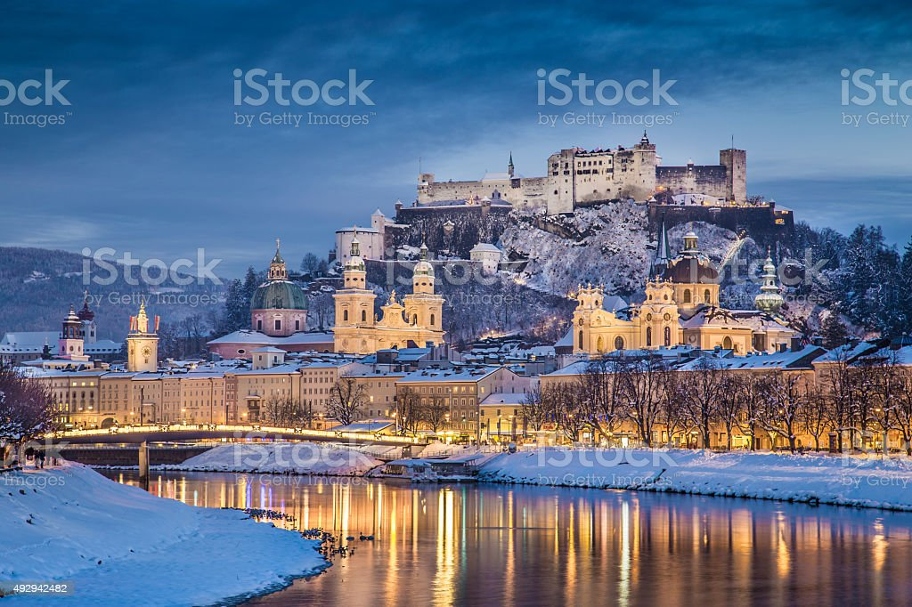 Historic city of Salzburg in winter at dusk, Austria stock photo