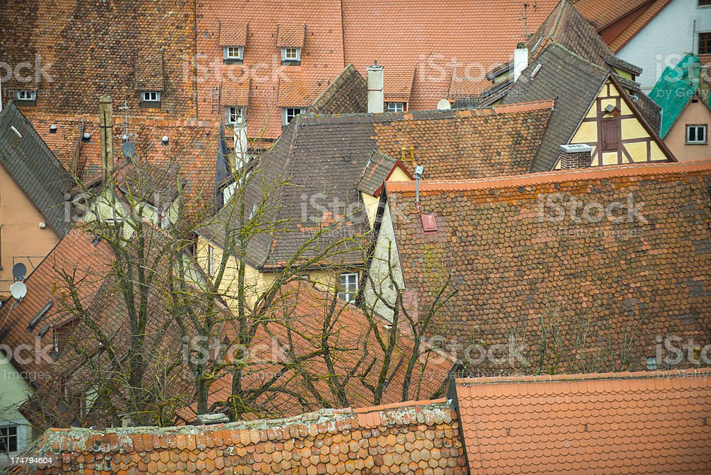 Historic, crooked rooftops with red colored tiles from above. royalty-free stock photo