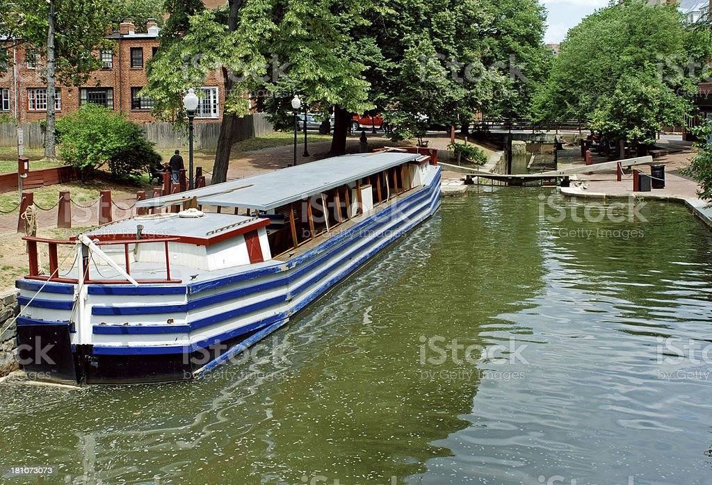 Historic freight boat at lock on canal in Washington DC royalty-free stock photo