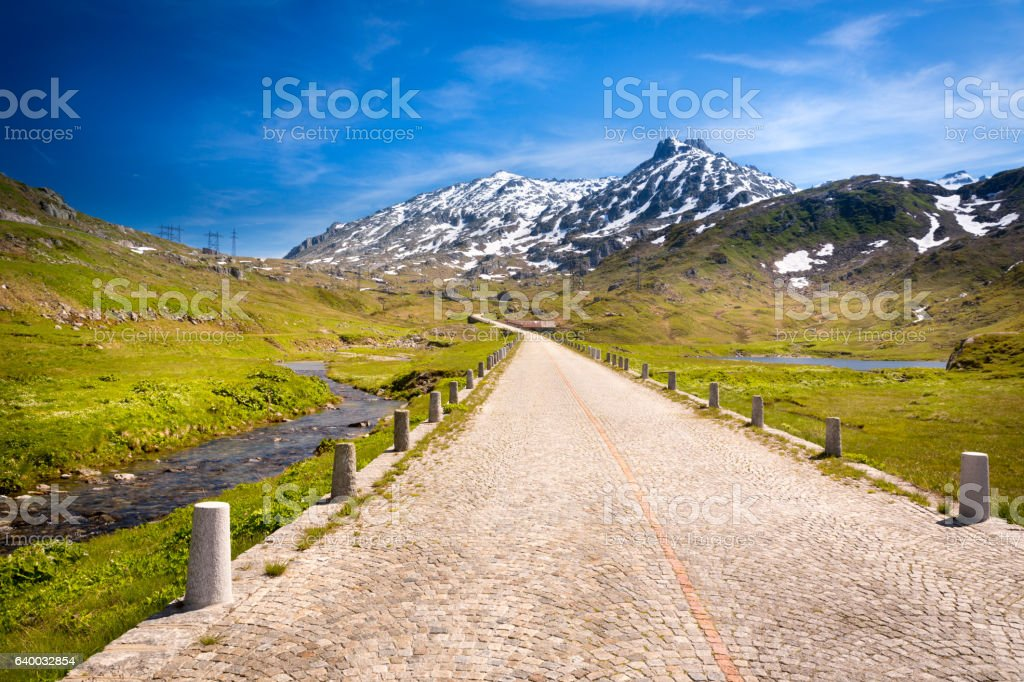 Historic Gotthard pass road with cobblestones, Alps, Italy stock photo