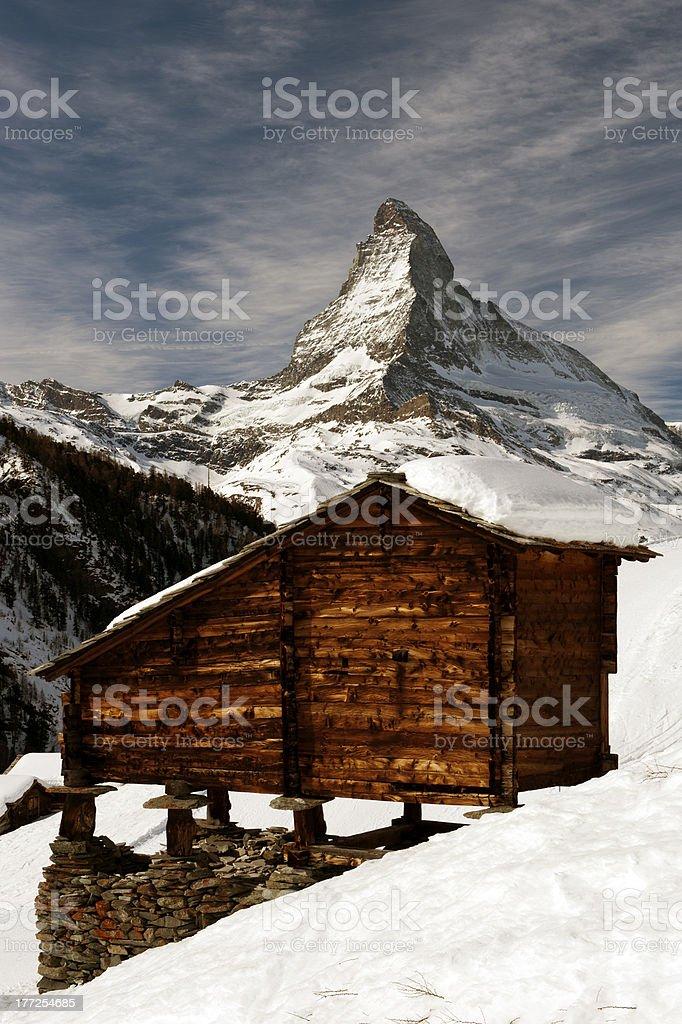 Historic Hayrick on Staddle Stones with Matterhorn stock photo