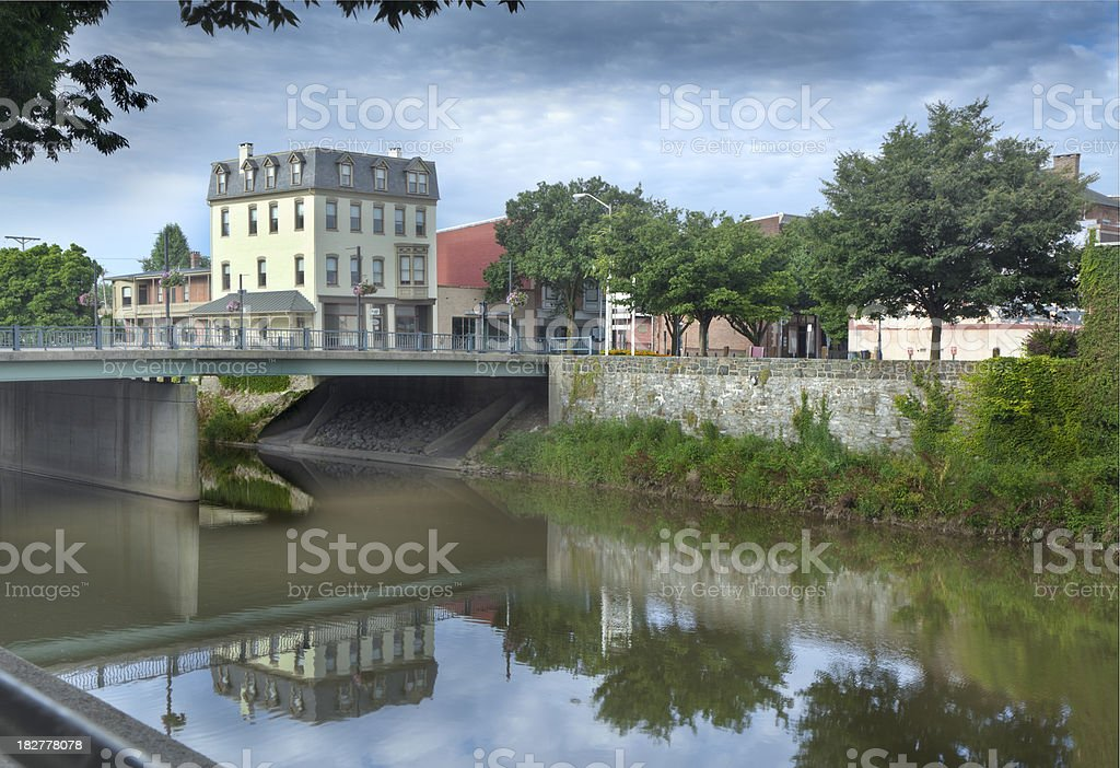 Historic Hotel, Bridge and Trees Reflecting in Codorus Creek stock photo