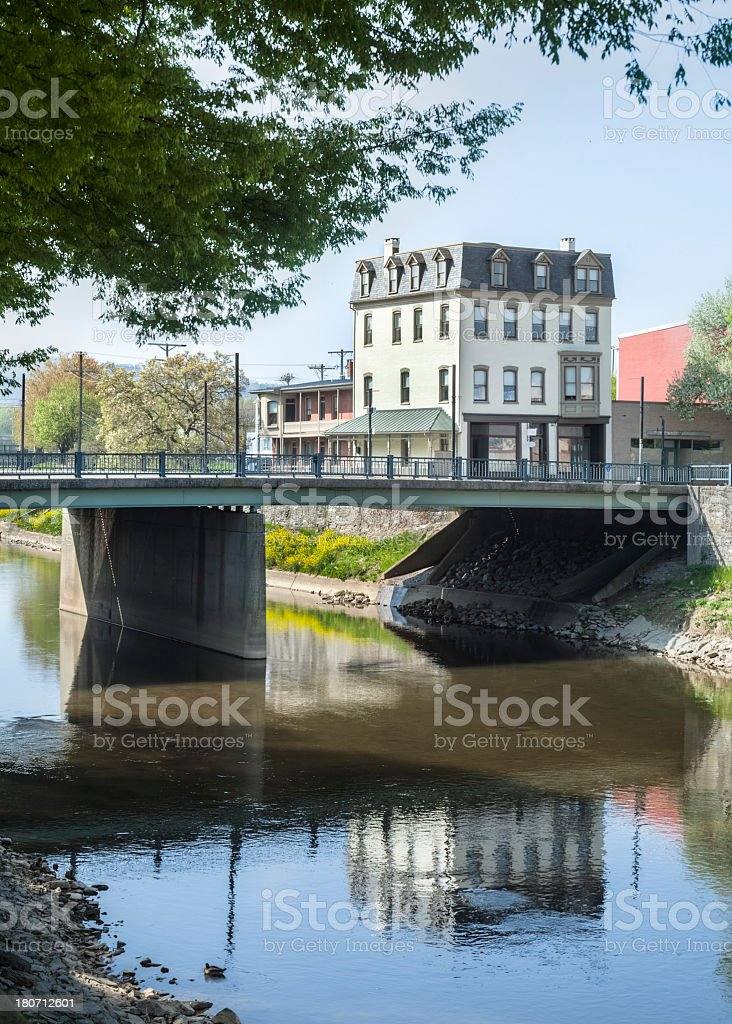 Historic Hotel Reflected in Codorus Creek royalty-free stock photo