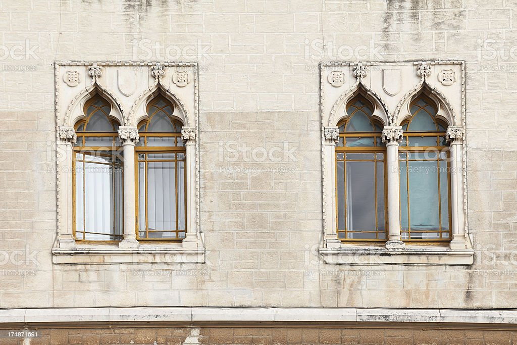 historic house facade with two venetian windows   Croatia royalty-free stock photo