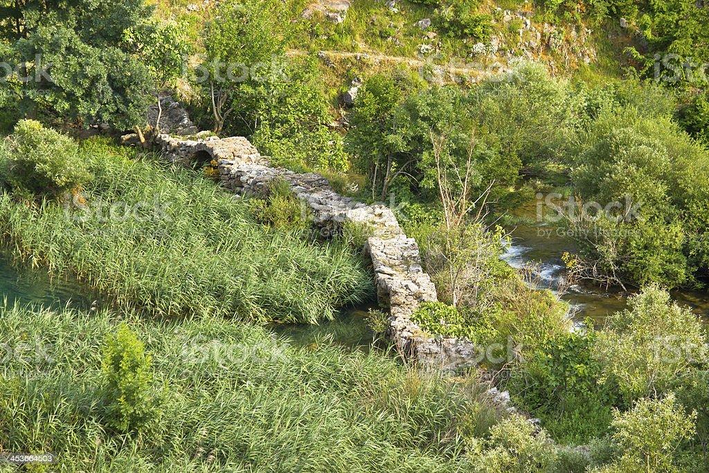 Historic Kudin bridge on Krupa river stock photo