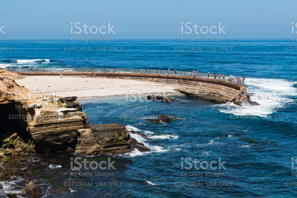 Historic La Jolla Children's Pool with Eroded Cliffs stock photo
