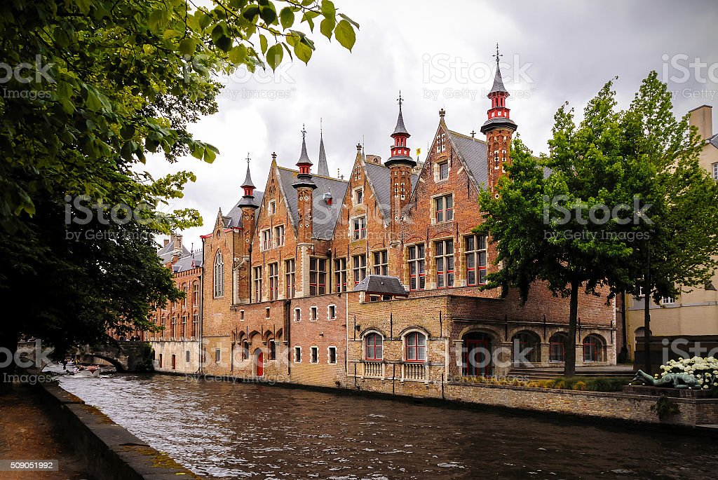 Historic medieval buildings along a canal in Bruges, Belgium stock photo
