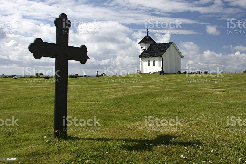 Historic Norwegian Church with cross gravestone royalty-free stock photo