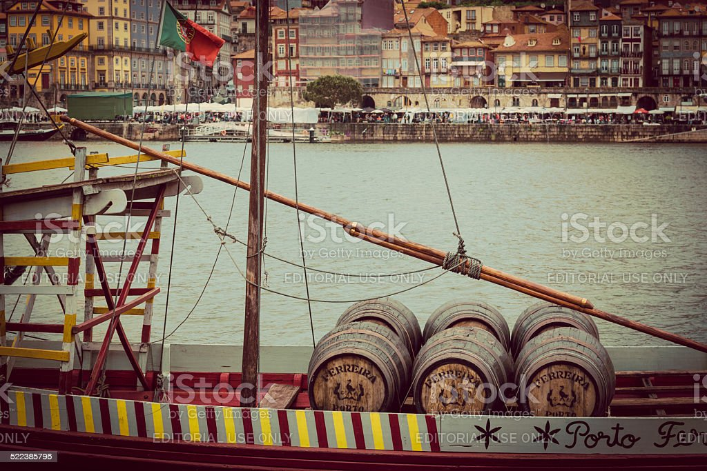 historic port wine boat on douro river in porto stock photo