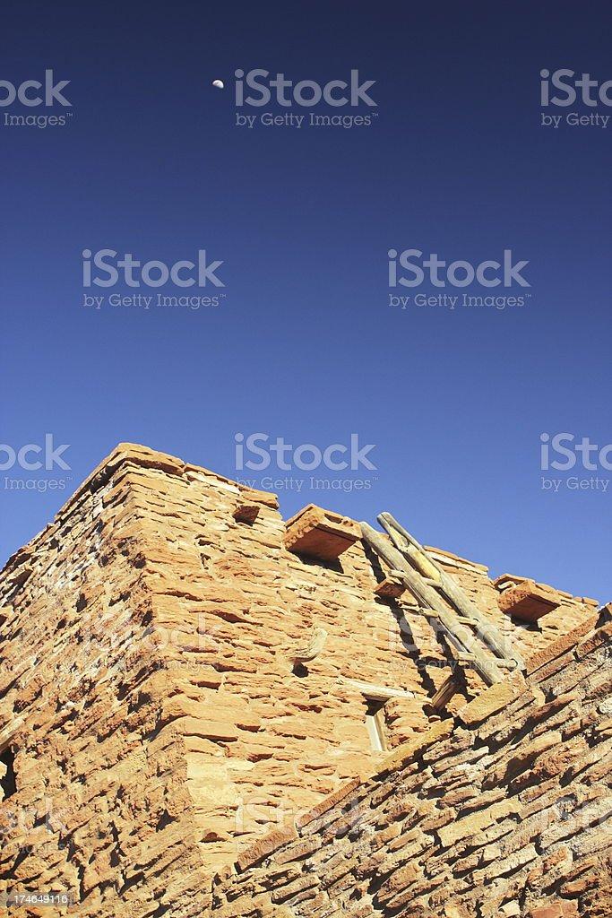 Historic Pueblo Dwelling Moon stock photo