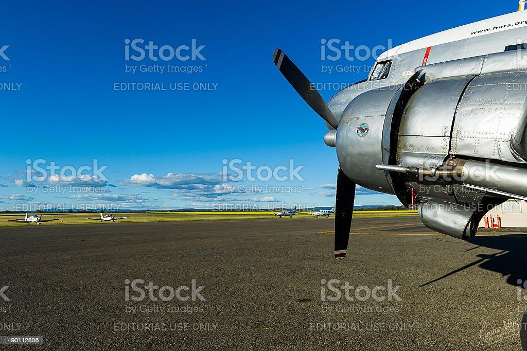 Historic RAAF DC-3 Dakota and canola fields stock photo