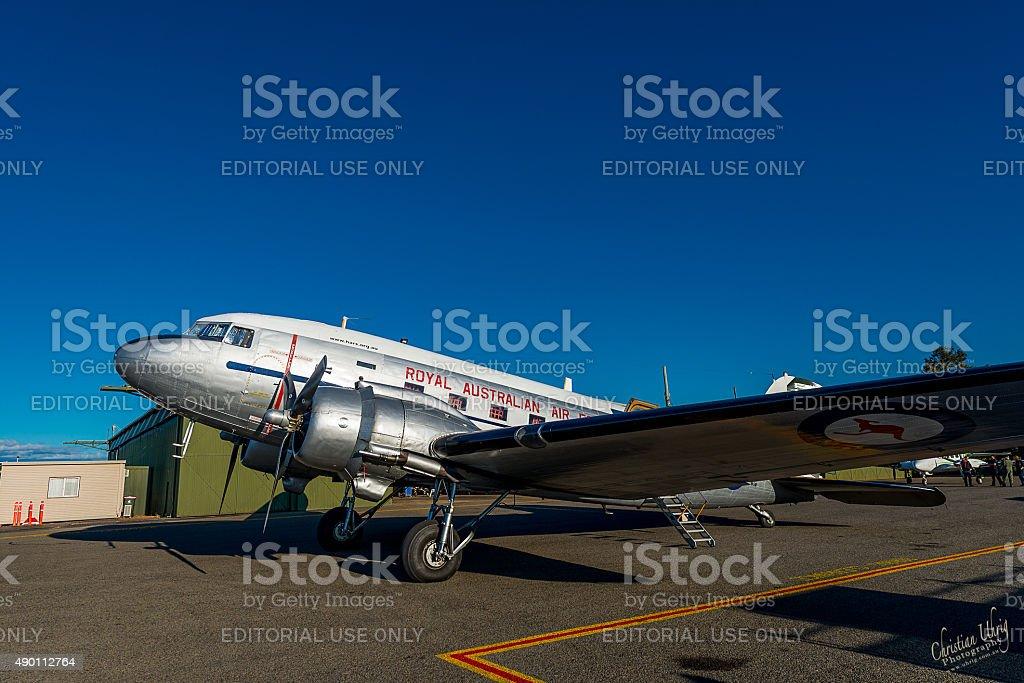 Historic RAAF DC-3 Dakota in front of hangar stock photo