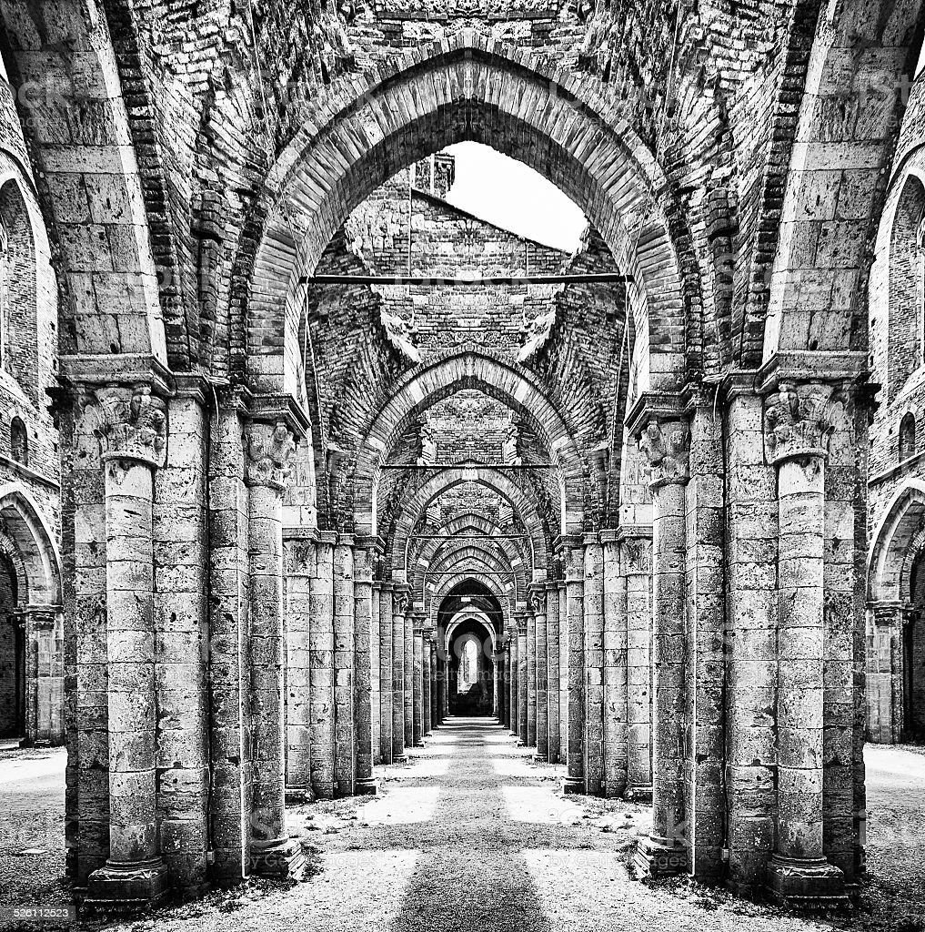 Historic ruins of abandoned abbey in black and white stock photo