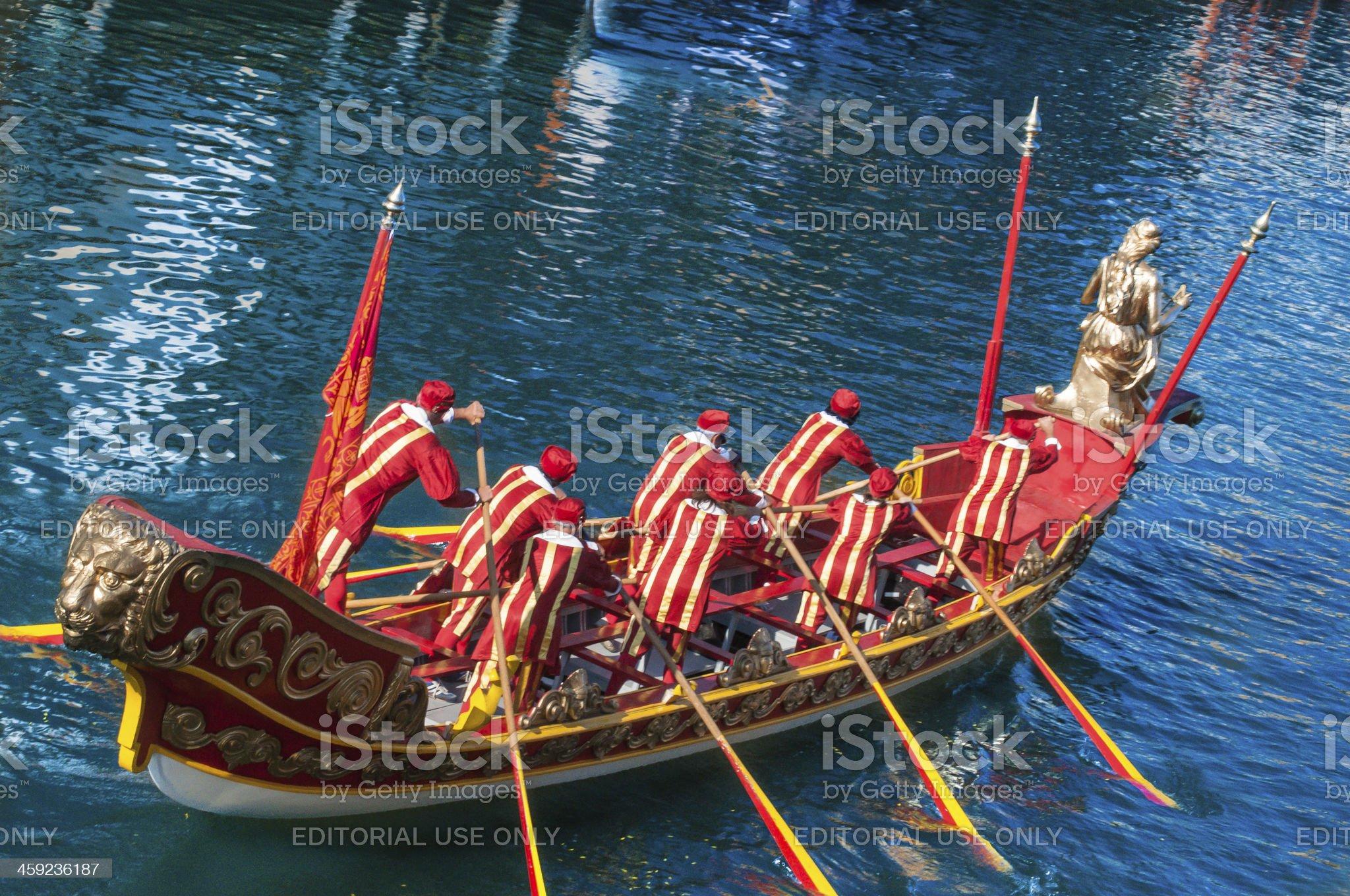 Historic seven man gondola plies Venice's Grand Canal royalty-free stock photo