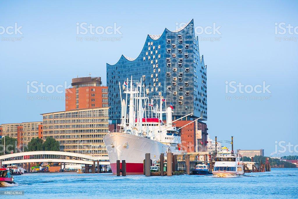 Historic ship in front of the new Elbphilmarmonie stock photo