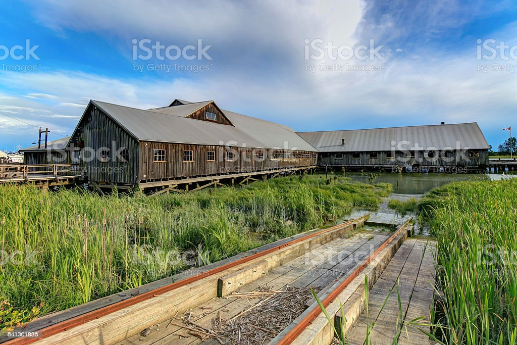Historic shipyard and rails stock photo