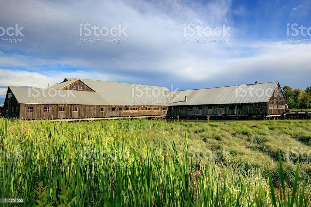 Historic shipyard with meadows stock photo