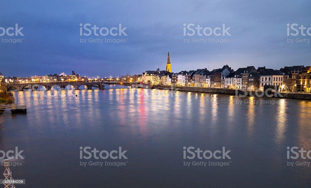 Historic skyline of Maastricht at night stock photo