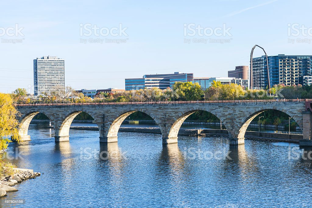 Historic Stone Arch Bridge over the Mississippi River in Minneapolis stock photo