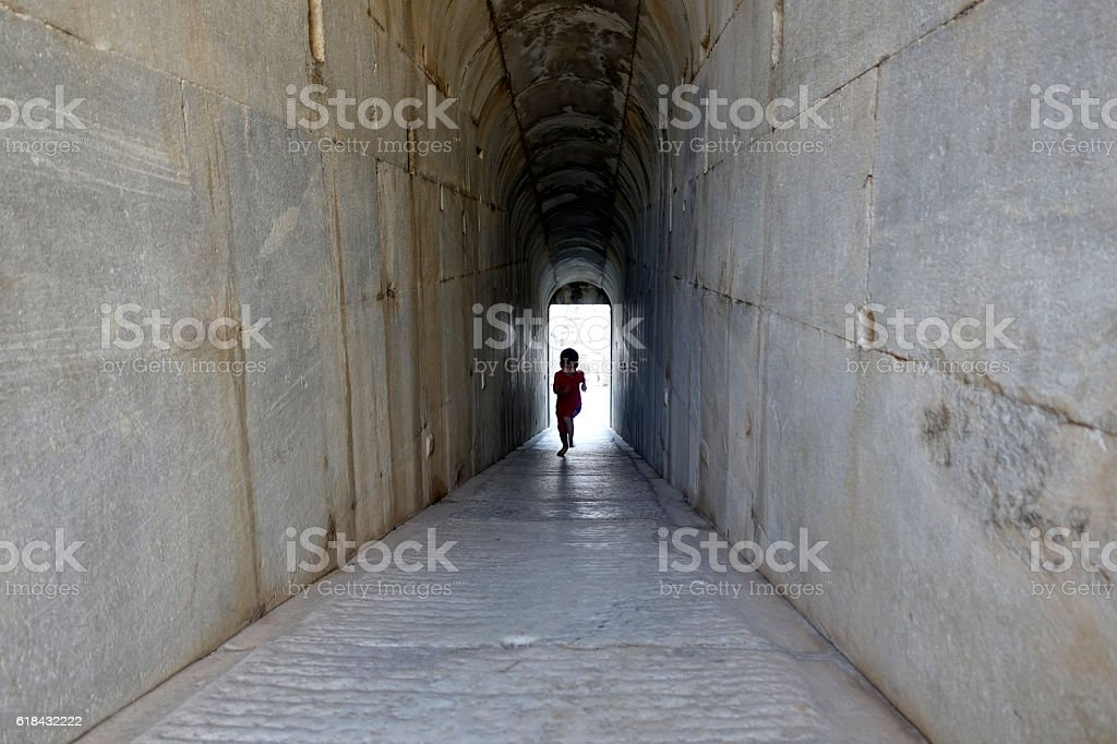 Historic Temple corridor. Cute little boy running. stock photo