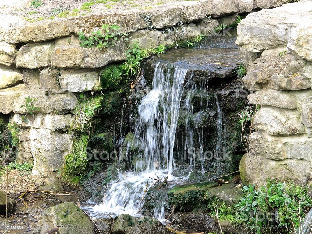 Historic  waterfall in Mote Park stock photo