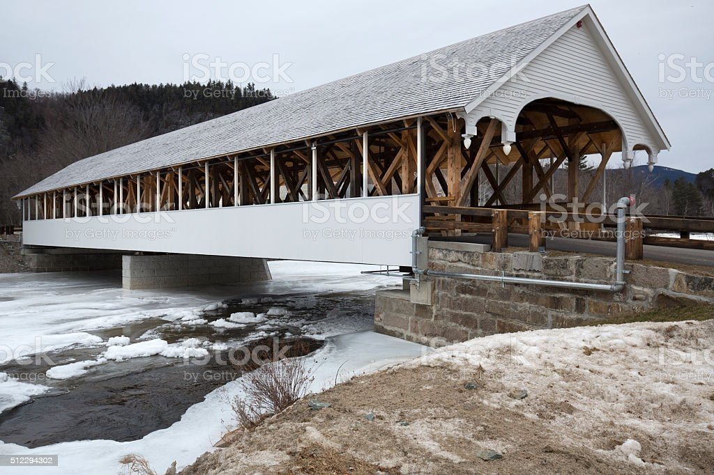 Historic white covered bridge, Ammonoosuc River, Stark, New Hampshire. stock photo